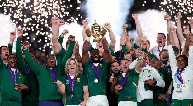 Just champion: South Africa skipper Siya Kolisi lifts the World Cup