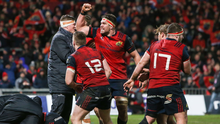 Marching on: Munster's Billy Holland celebrates as Simon Zebo scores a try