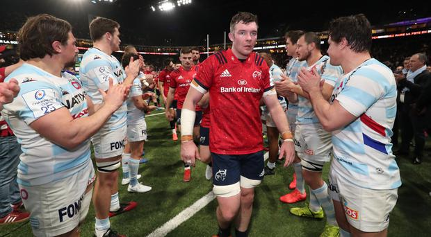 Gallant losers: Munster's Peter O'Mahony and his team-mates are applauded off by Racing after the match on Sunday