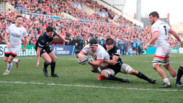Touch down: Marcell Coetzee scores a try despite the attention of Bath's Josh Bayliss at the Kingspan