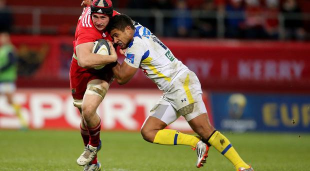 Squeeze: Tommy O'Donnell is tackled by Wesley Fofana