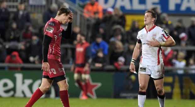 Off you go: Scarlets full-back Liam Williams gets his marching orders watched by Ulster's Craig Gilroy