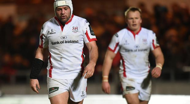 Dejection: Ulster's Rory Best (left) and Luke Marshall (right) exit Parc y Scarlets and Europe