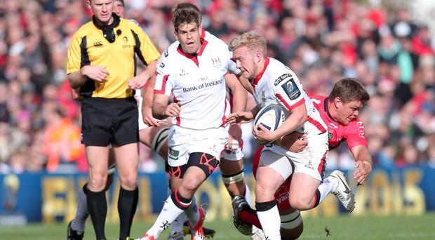 Brought down: Stuart Olding gets tackled by Toulon's Juan Smith at the Kingspan Stadium