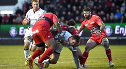 Ulster's Jared Payne gives it his all at the Stade Mayol but Toulon's players are up to the task