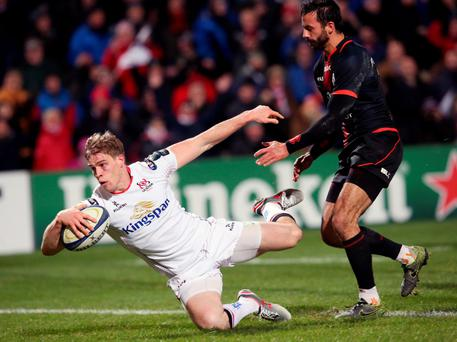 Over the line: Andrew Trimble dives to touch down for Ulster's second try against Toulouse