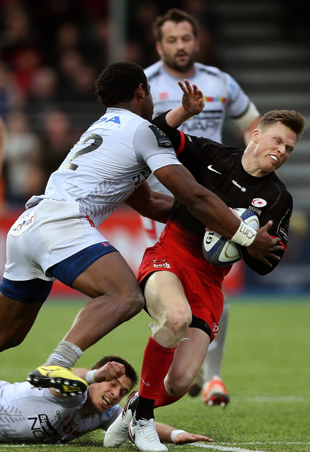 Crunch time: Uwa Tawalo of Oyonnax tackles Saracens' Chris Ashton at Allianz Park last month