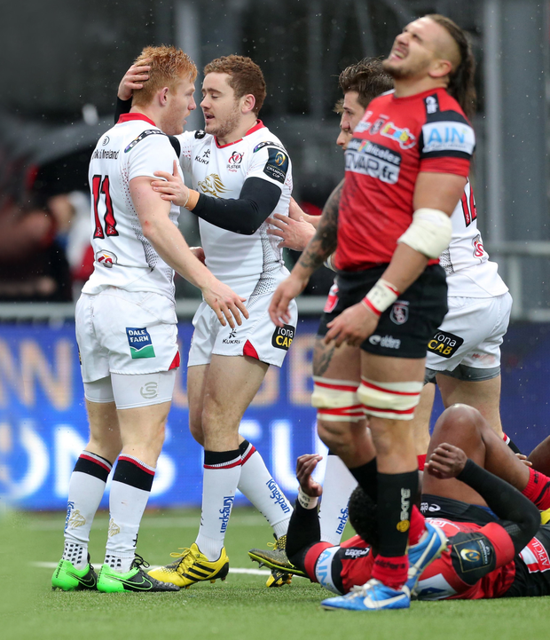 Joy-onnax: Rory Scholes celebrates with Paddy Jackson at moment of Ulster victory yesterday amid their opponent's despair
