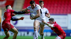 Full steam ahead: Jacob Stockdale on the charrge for Ulster against Scarlets