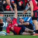 Big impact: Munster's JJ Hanrahan celebrates scoring his side's third try