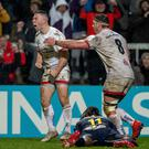 Magic moment: Ulster's John Cooney celebrates his try on Friday night with Marcell Coetzee
