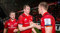 Job done: Munster's Chris Farrell and Mike Haley after their rain-swept victory against Saracens at Thomond Park