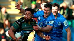 Waiting game: Northampton's Matt Proctor clashes with Leinster star Johnny Sexton