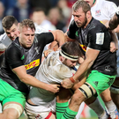 Taken down: Ulster's Iain Henderson is tackled by Alex Dombrandt and Chris Robshaw of Harlequins