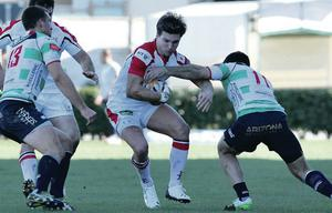Under pressure: Michael Allen tries to evade a tackle from Treviso's Andrea Pratichetti during Ulster's hard-fought win in Italy
