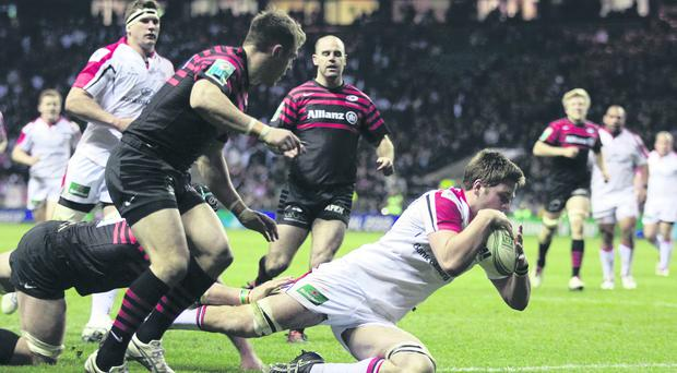 Iain Henderson goes over for Ulster's late score in their Heineken Cup defeat