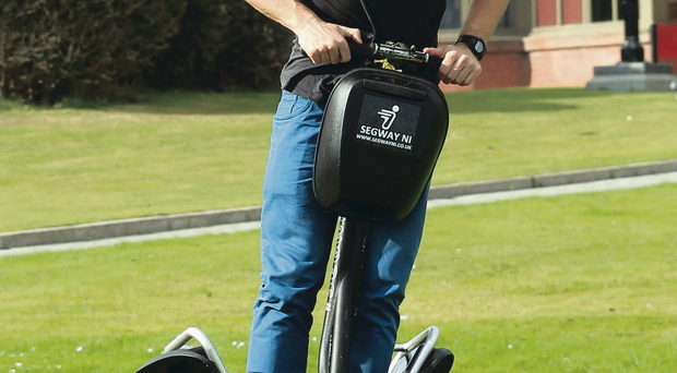 Two-wheel drive: Tommy Bowe enjoys a Segway spin at the Ulster squad's Slieve Donard hideaway ahead of tonight's game