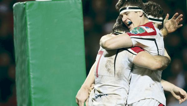 Over the line: Ulster's Sean Doyle celebrates Saturday's fifth try with team-mate Robbie Diack