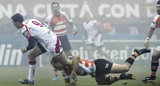 Ulster's Ruan Pienaar gets away from Treviso's Alberto Sgarbi at Stadio Monigo