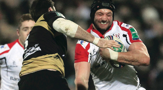Ulster's Dan Tuohy is tackled by Montpellier's Johnnie Beattie last night