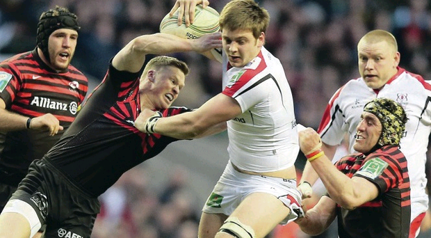 Ulster's Iain Henderson is held by Chris Ashton and Kelly Brown of Saracens in last year's Heineken Cup quarter-final