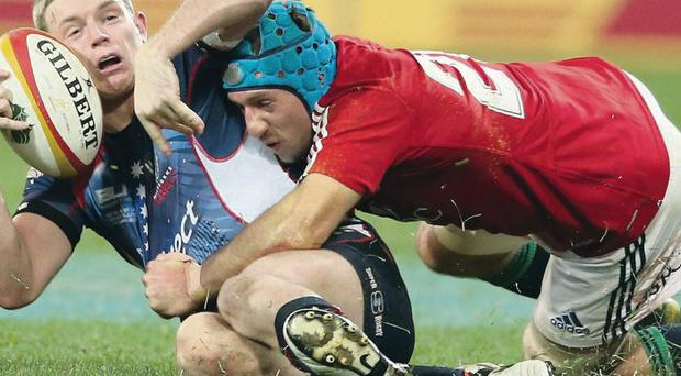 MELBOURNE, AUSTRALIA - JUNE 25: Bryce Hegarty of the Rebels is tackled by Justin Tipuric during the International Tour Match between the Melbourne Rebels and the British & Irish Lions at AAMI Park on June 25, 2013 in Melbourne, Australia. (Photo by David Rogers/Getty Images)