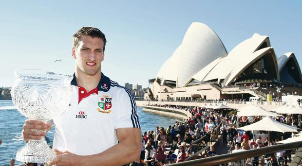Tour captain Sam Warburton poses with the Tom Richards Cup at the Sydney Opera House