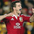 Jonathan Sexton of the Lions celebrates scoring a try during the International Test