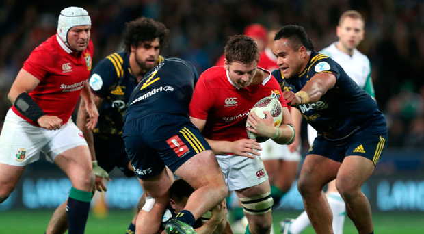 Action stations: Iain Henderson breaks through the Highlanders defence