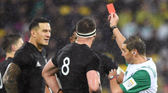Seeing red: Referee Jerome Garces gives Sonny Bill Williams his marching orders after a high tackle on Anthony Watson