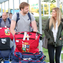 Welcome home: Lions player Iain Henderson arrives at Belfast City Airport, greeted by fiancé Suzanne Flanagan. Rory Best is also pictured