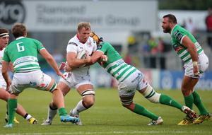 Tackle: Ulster star Roger Wilson is held up during his side's comfortable victory over Treviso