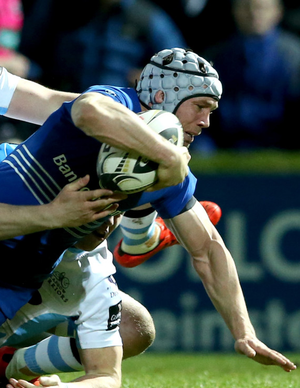 Inflicting damage: Leinster's Isaac Boss scores a try