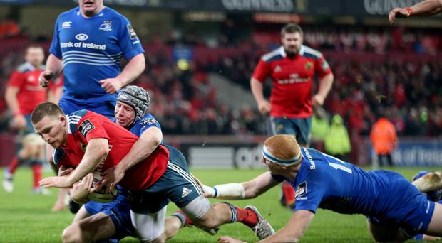 Over you go: Munster's Andrew Conway scores a try