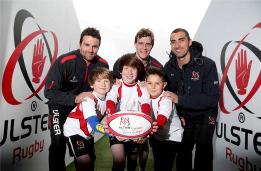 Summer scrums: Ulster Rugby stars Jared Payne, Andrew Trimble and Ruan Pienaar get ready to pass some expert advice on to young players Joe McDermott, Dylan McDermott and Charlie Adams as they kick-off this year's Centra Ulster Rugby Summer Camps