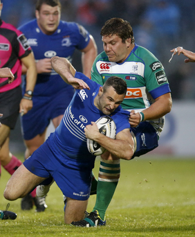 Holding on: Dave Kearney is tackled by Rupert Harden