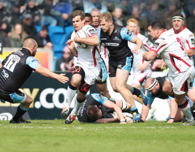 On the charge: Ulster's Louis Ludik attempts to break through