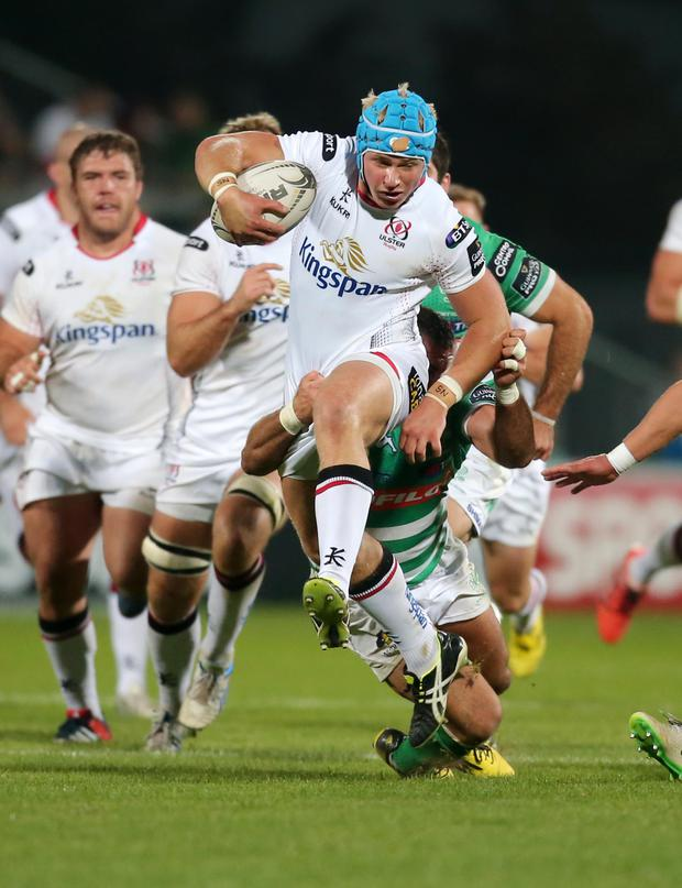 Jump to it: Luke Marshall breaks a tackle against Treviso