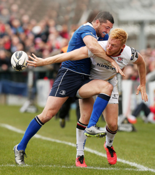 Hard fought: Rory Scholes manages to hold off Rob Kearney
