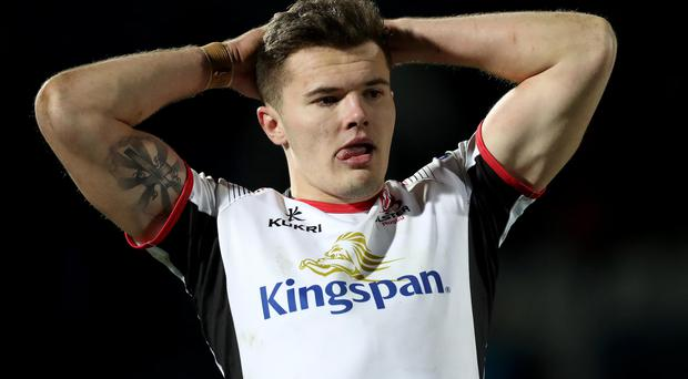 Hard to take: Jacob Stockdale, scorer of Ulster's consolation try, is dejected at the end of the heavy defeat to Leinster