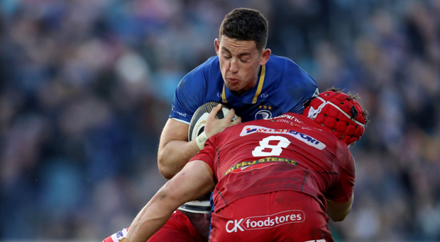 Battling through: Leinster's Noel Reid takes on Phil Price and Josh Macleod of Scarlets