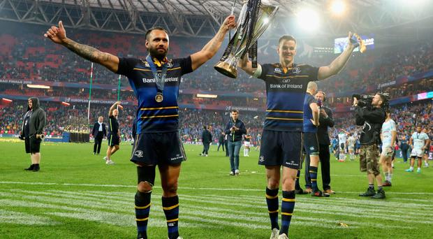 Glory trail: Leinster captain Isa Nacewa and Jonathan Sexton celebrate their Champions Cup victory last week