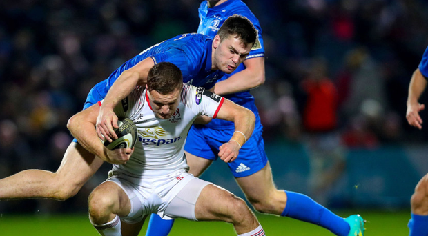 Held up: Ulster ace Johnny McPhillips finds no way through against Conor O'Brien of Leinster