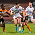 On attack: Ulster's James Hume is tackled by Junior Pokomela at the weekend