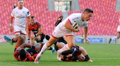 Touch down: Ulster's John Cooney scores a try