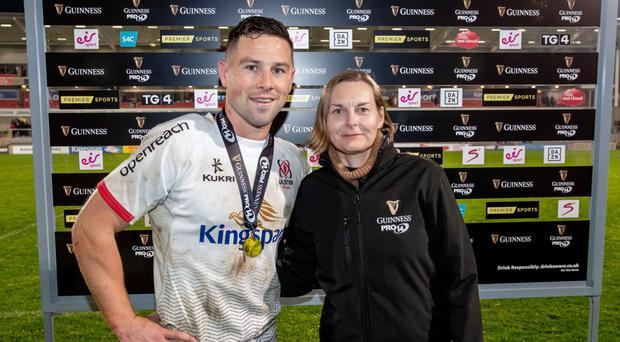 Top display: Sara Rogers of Guinness presents the Guinness Man of the Match award to Ulster's John Cooney