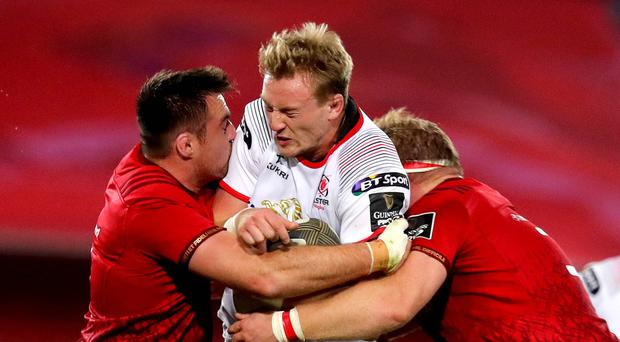Crunch: Munster's Niall Scannell and Stephen Archer tackle Kieran Treadwell of Ulster in last season's clash at Thomond Park