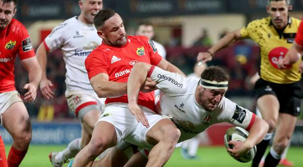 Rob joy: Ulster's Rob Herring on his way to scoring a try despite the efforts of Alby Mathewson of Munster