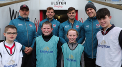Learning curve: Kingspan competition winners enjoyed a coaching masterclass with Ulster Rugby senior players Jordi Murphy, Will Addison and Louis Ludik, as well as Head Coach Dan McFarland in Kingspan stadium yesterday