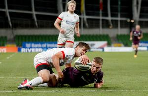 No stopping: Scott Penny scores a try for Leinster despite the efforts of Ulster's Louis Ludik